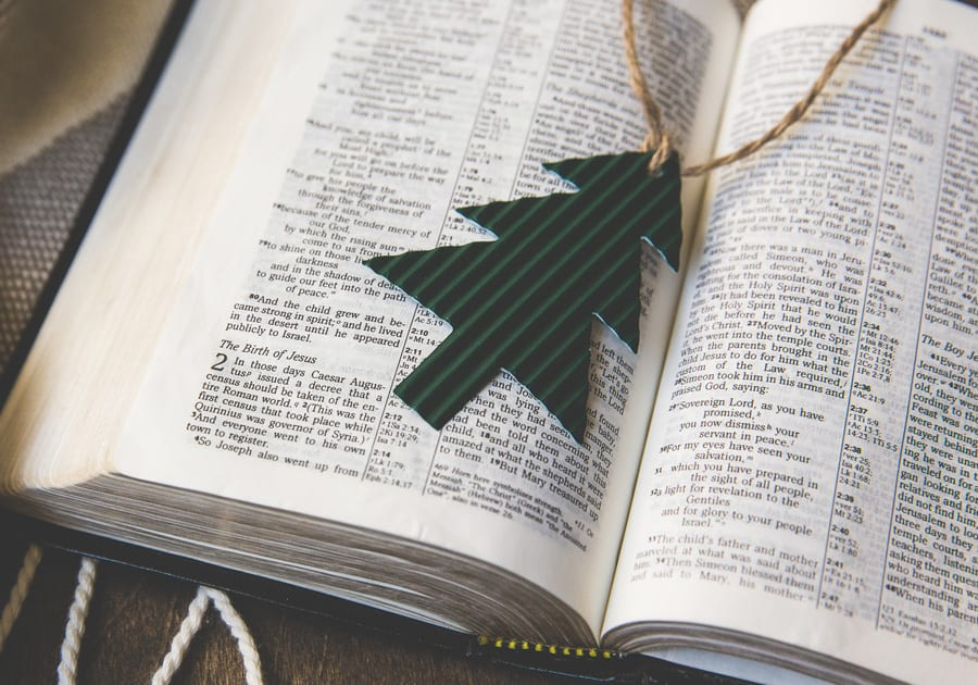 Bible with Christmas tree ornament