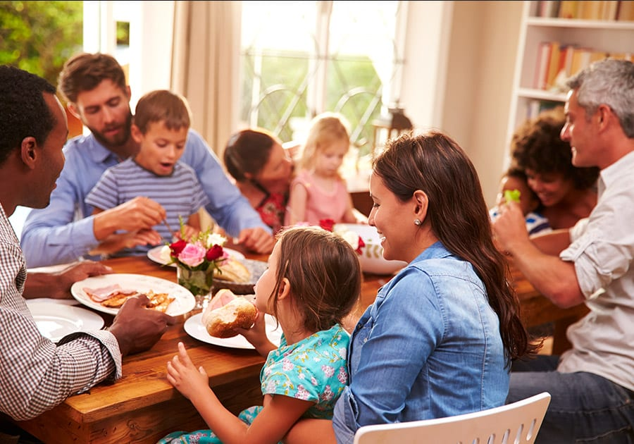 Family eating meal around dining table