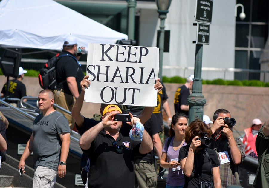 People protesting the push for Sharia Law in New York City. (Shutterstock)