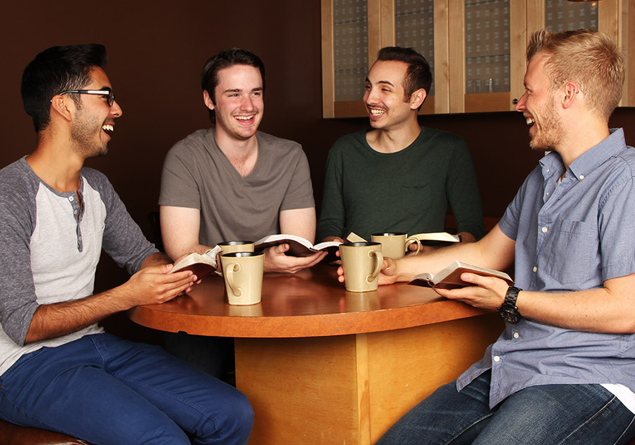 Men laughing at Bible study