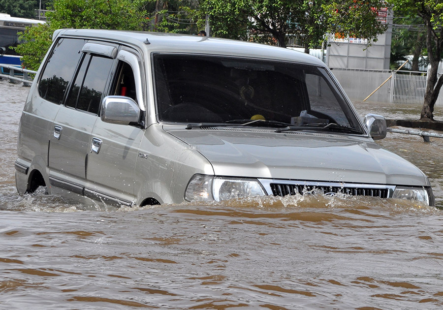 Car trapped in flood waters
