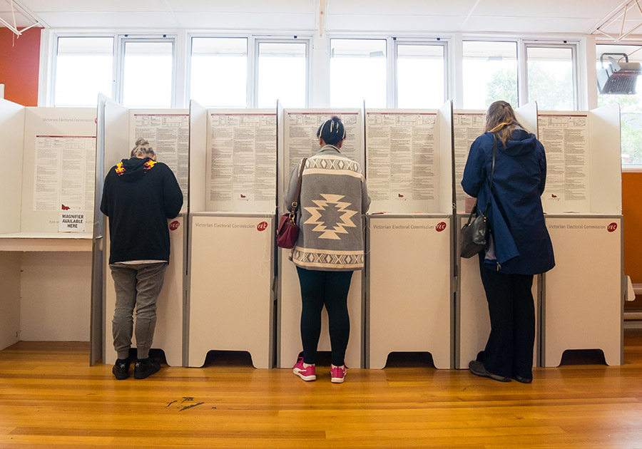 People voting in polling booth.