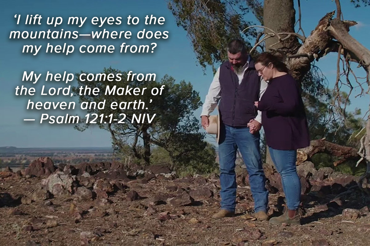 Couple praying for rain with scripture