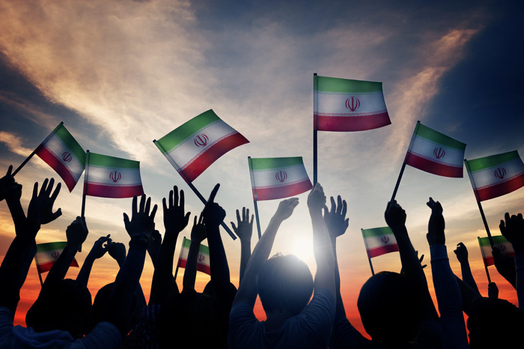 People waving Iran flags