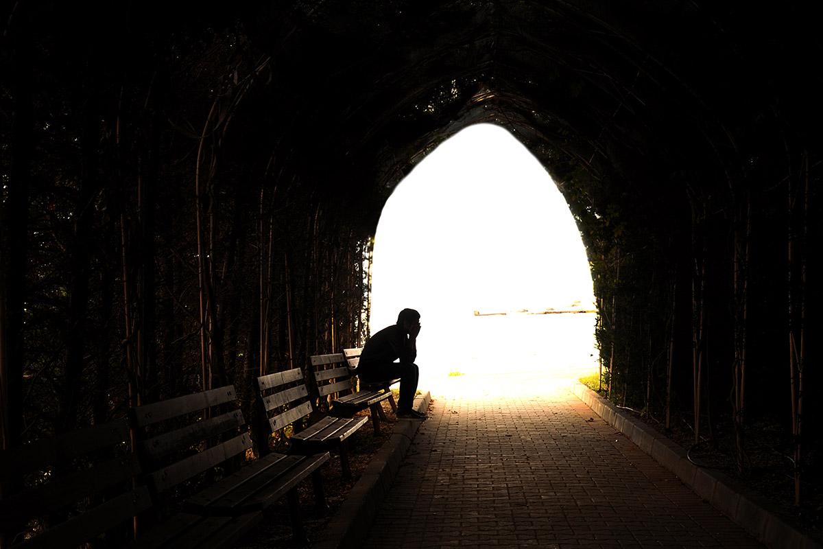 Man praying in cave