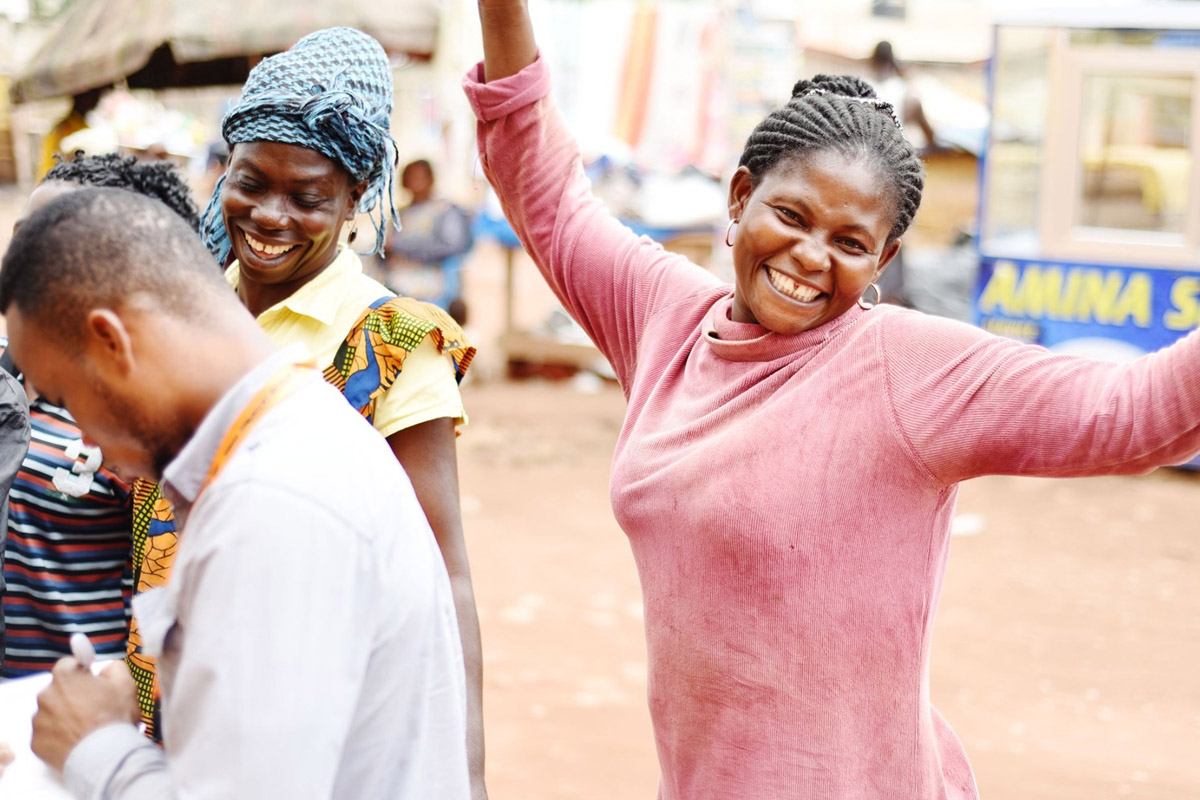 Happy woman in African village