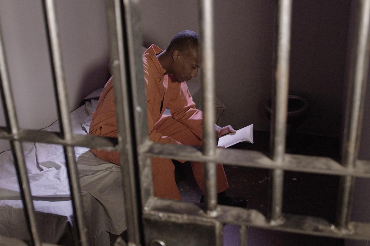 Prisoner reading the Bible