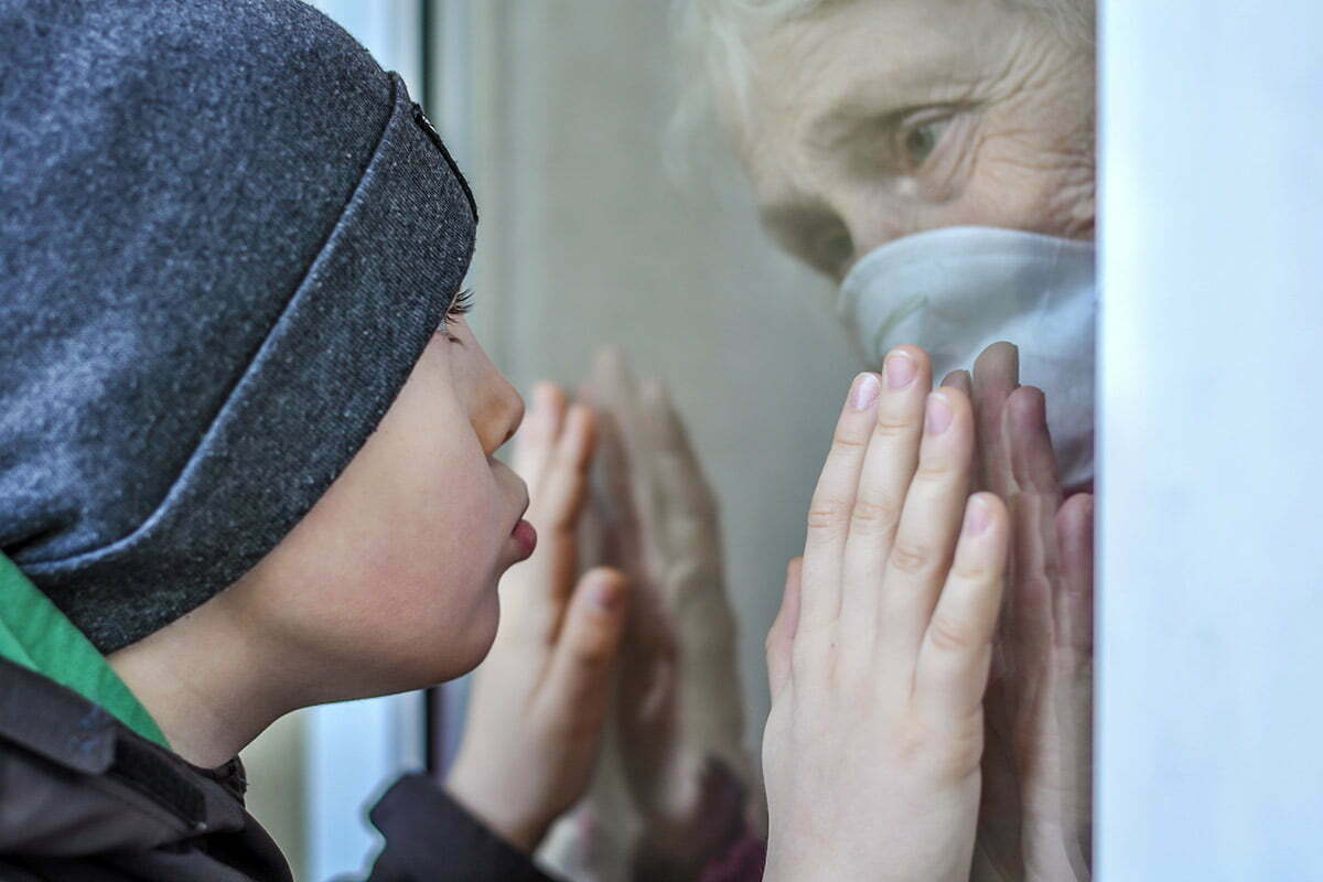 Grandson looking at grandmother in isolation