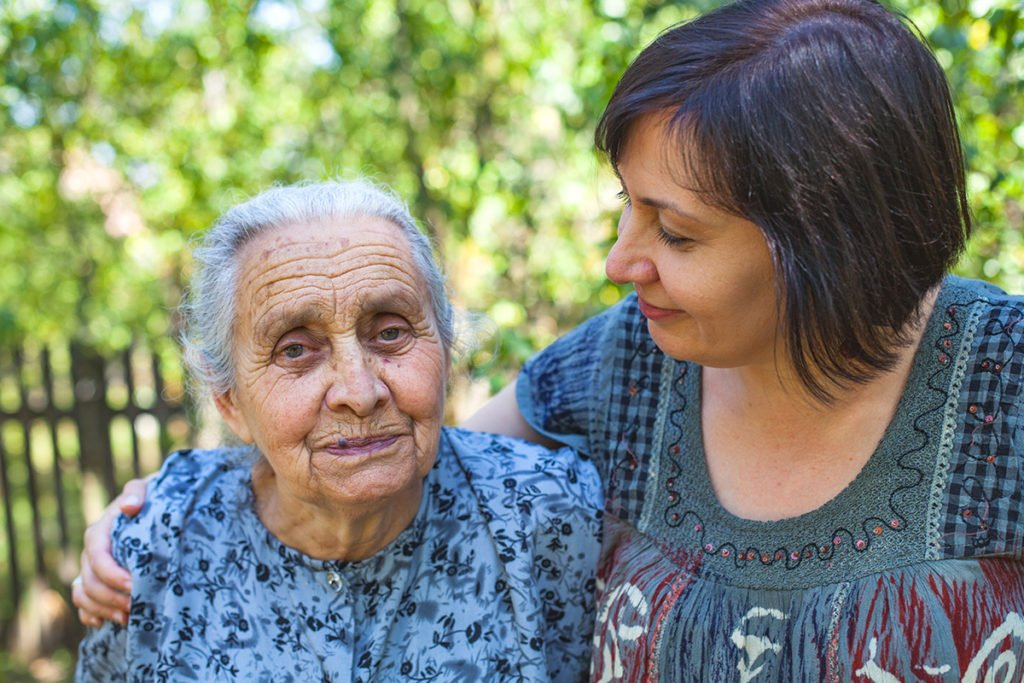 Woman caring for elderly parent