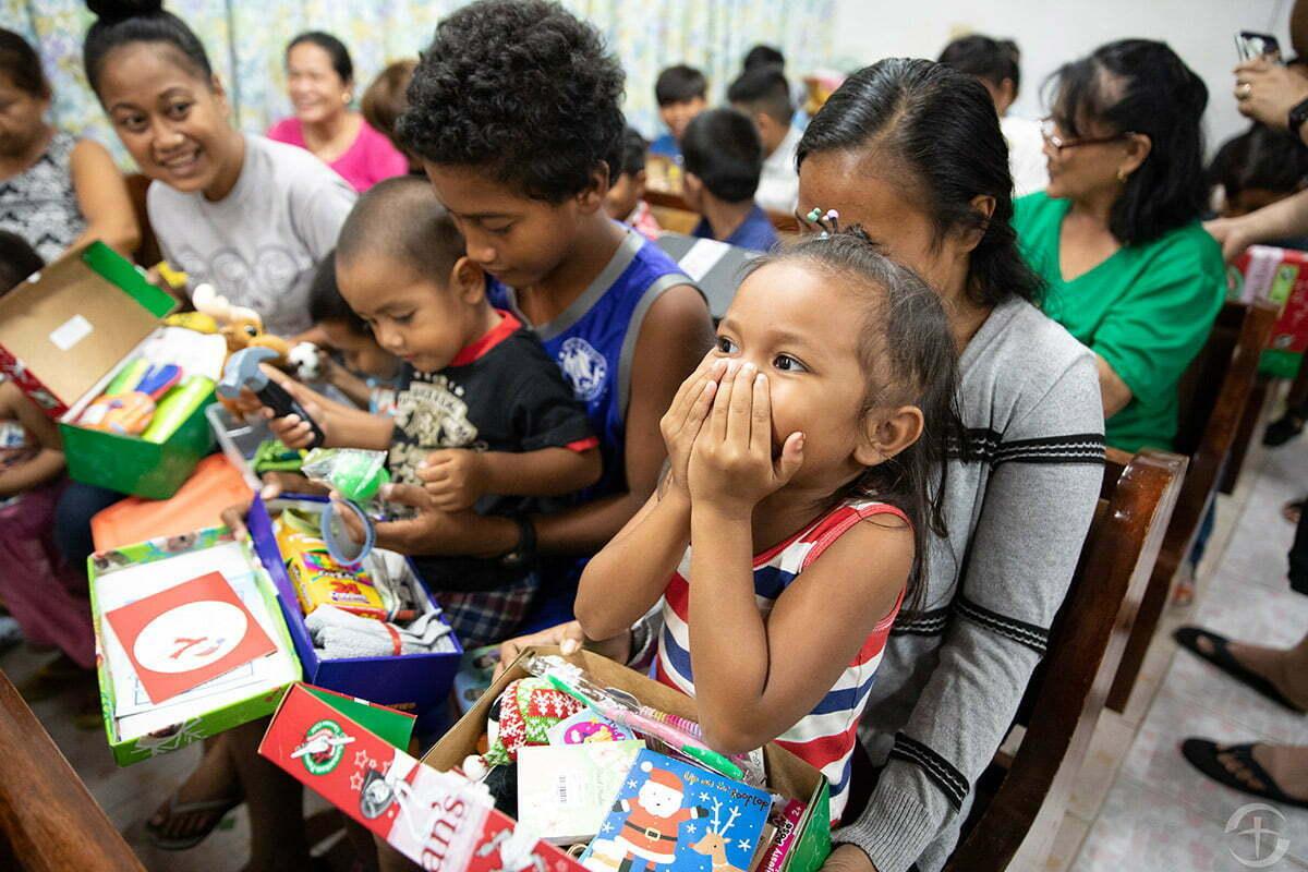 Children opening shoeboxes