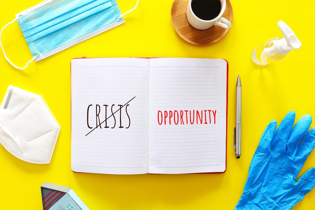 Book with crisis and opportunity written down