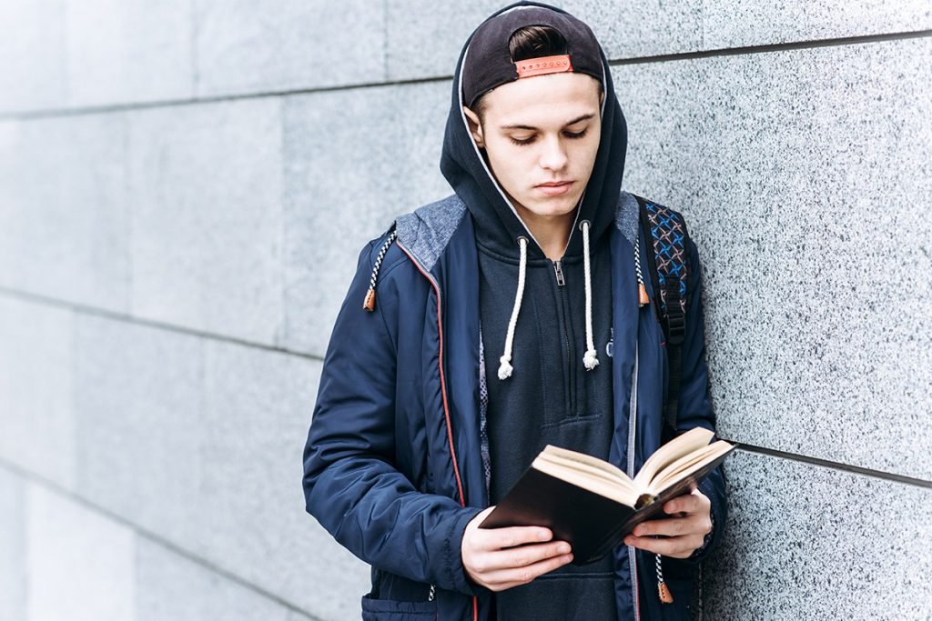 Teenager reading Bible
