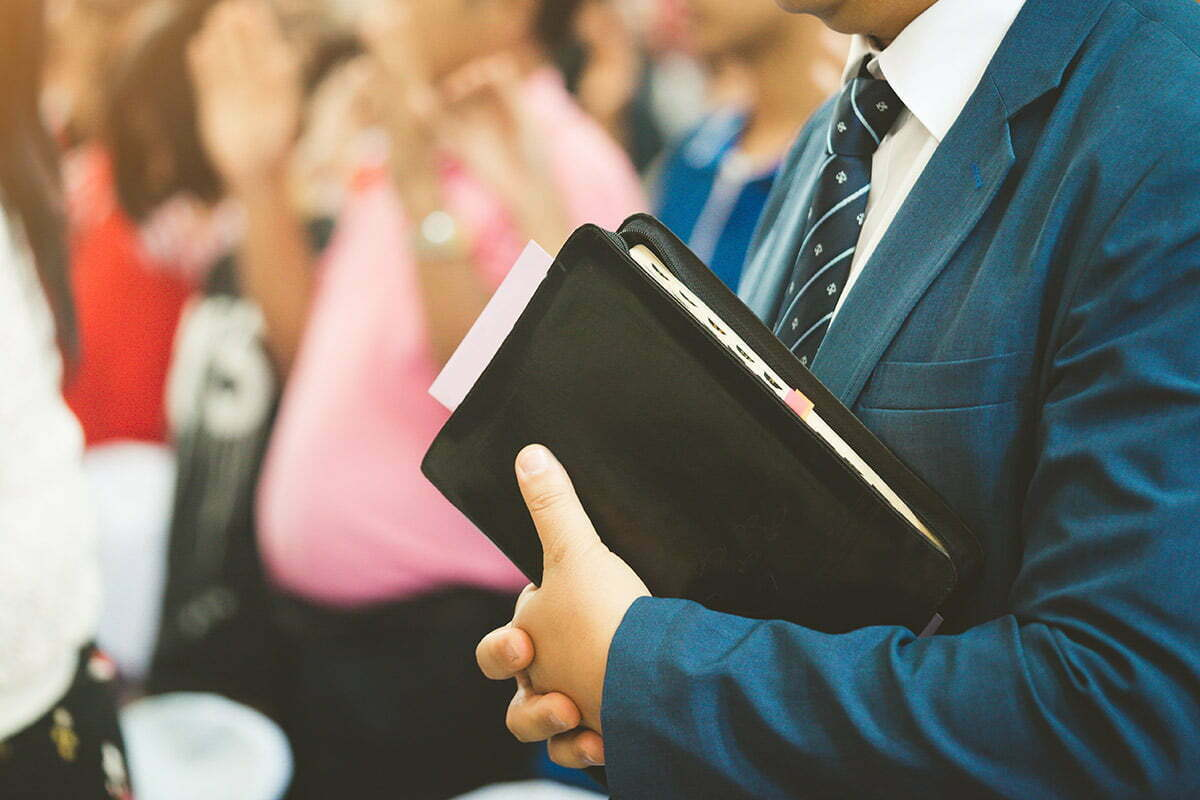 Church pastor holding Bible