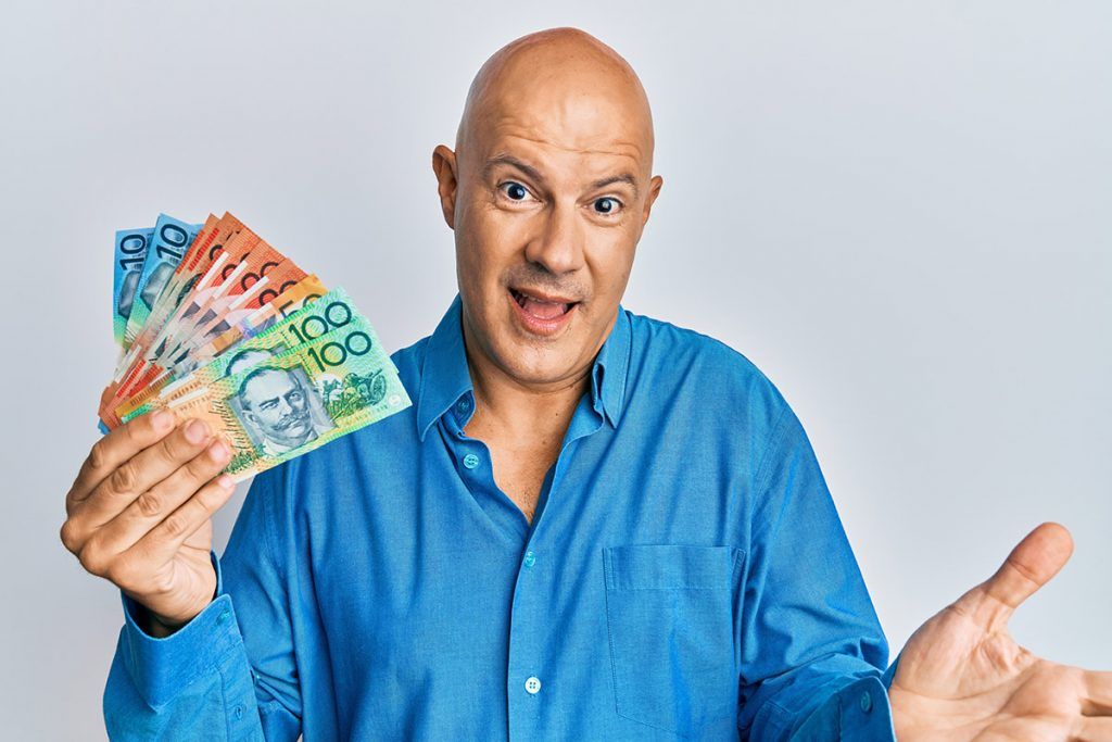 Man holding Australian currency
