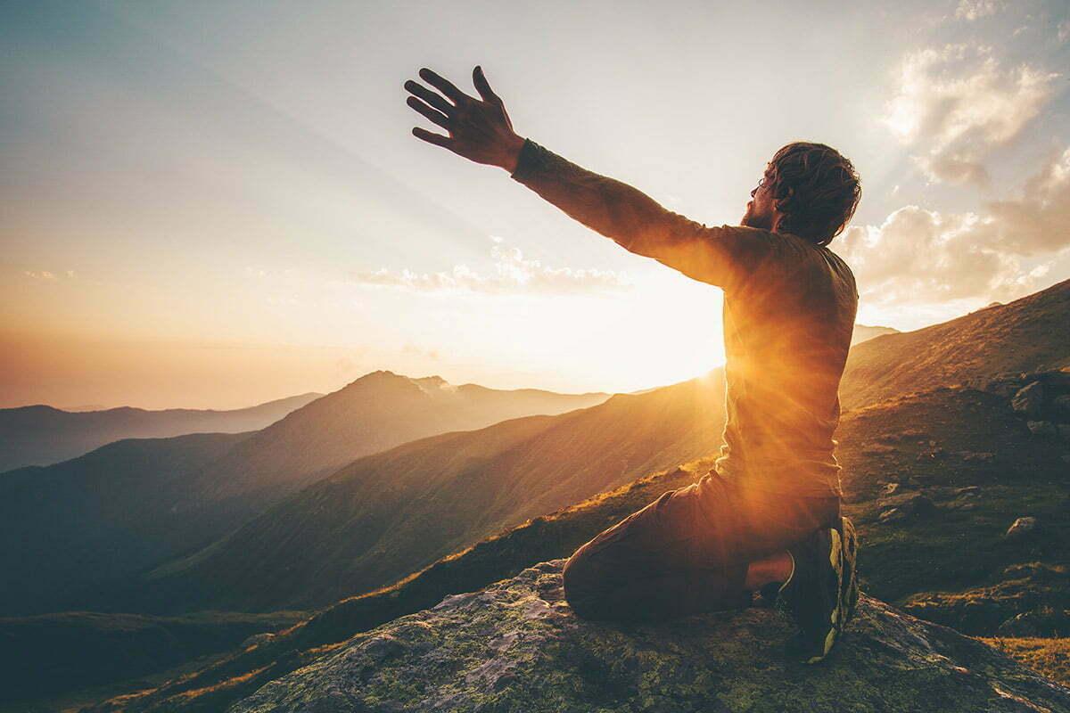 man praying on mountaintop