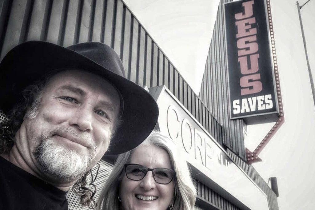 Jesus Saves sign with Steve Grace and his wife