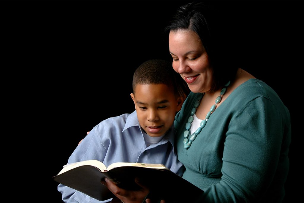 Mother reading Bible to child