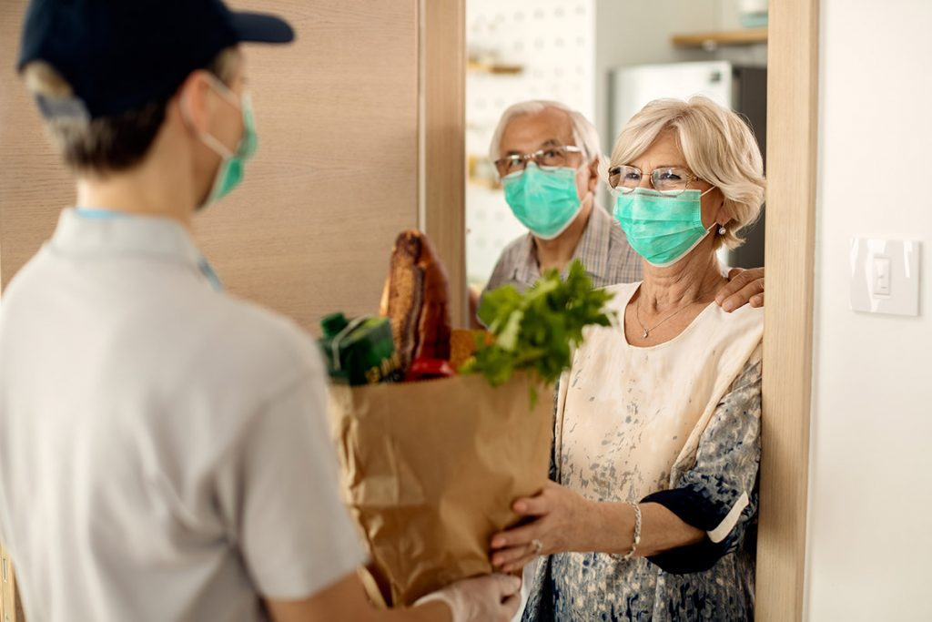 Food delivery wearing masks