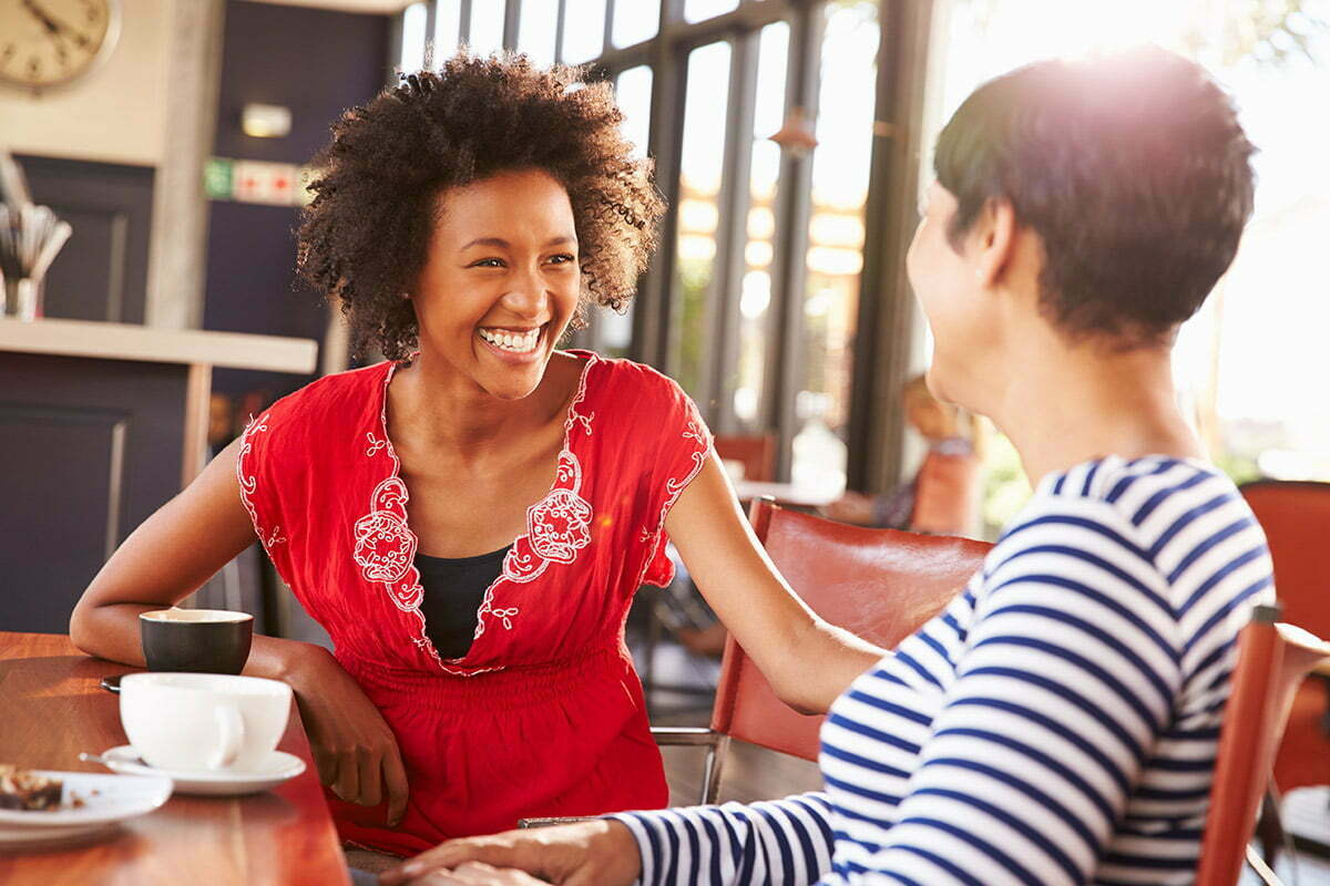 two women having conversation at cafe