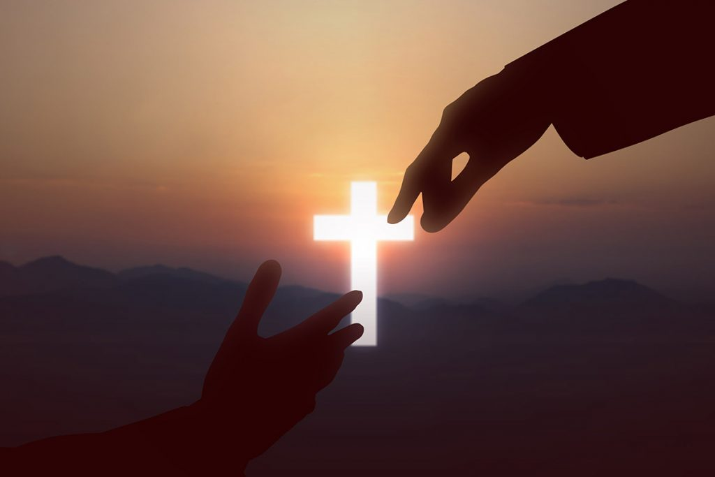 hand reaching out to christ