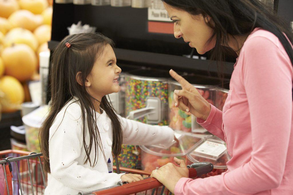 Child throwing tantrum in shopping trolley