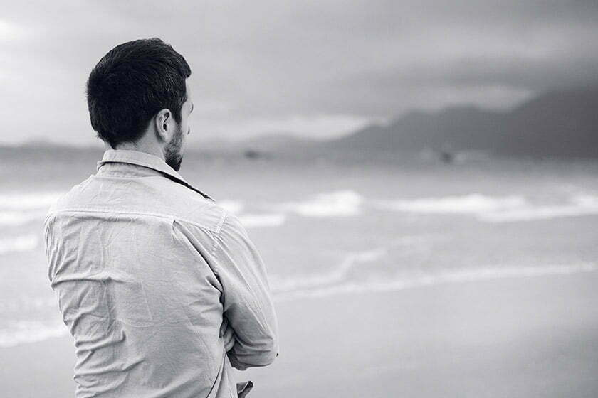 man looking out at ocean