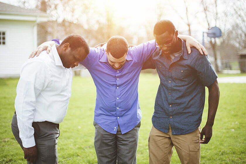 men praying together