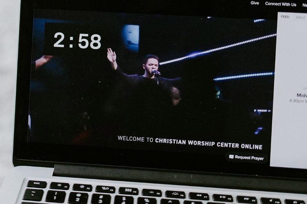 watching church on laptop