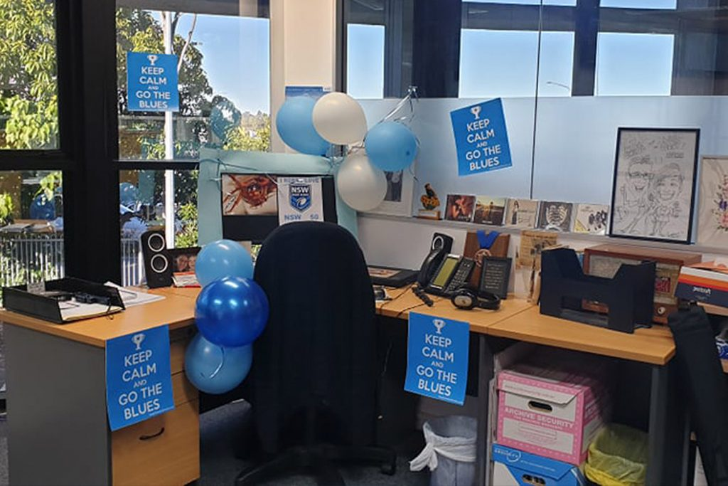 Robbo's desk decorated with Blue