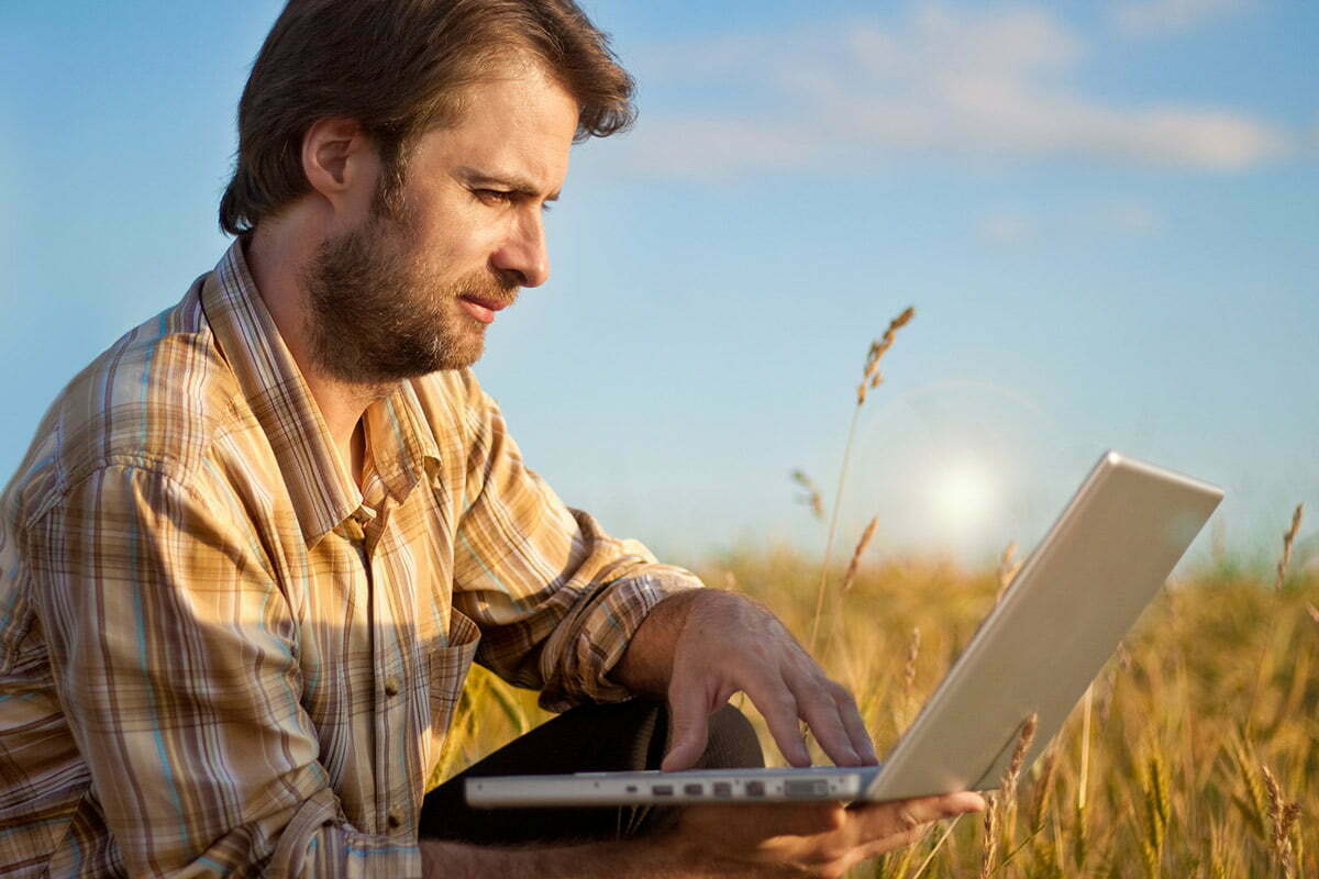 Farmer using laptop