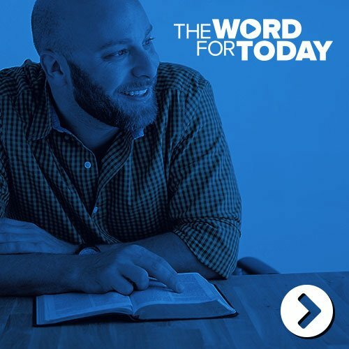 Man smiling and reading a bible